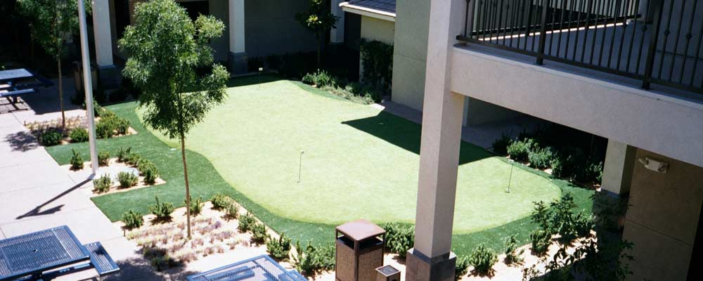 Putting tee in Albuquerque commercial complex courtyard