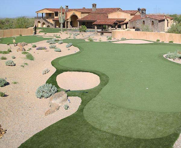 Putting green outside New Mexico Southwest-style home