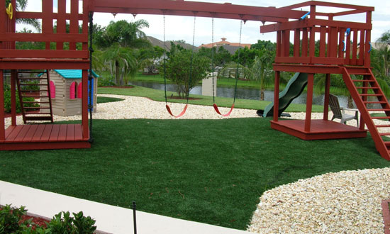 Backyard playground turf system with wooden play equipment