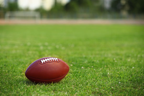 Isolated view of football on an artificial grass field